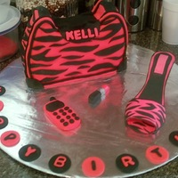 Pink Zebra Purse  The cake was for my 14th year old niece. I had a blast making the accessories. All accessories are fondant. Shoe is a combination gum paste...