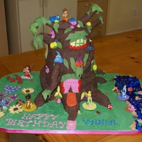 Disney Fairies' Pixie Hollow The disney fairies pixie hollow tree. Designed by my daughter for her birthday. four tiers of cake! Covered in chocolate and vanilla...