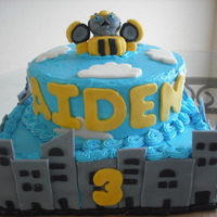 Transformers City/bumblebee With inspiration from CC. Bumblebee is made of fondant. Cake is buttercream, buildings and clounds fondant