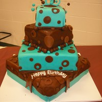 Mod 16Th Birthday Cake Offset square tiers, alternating teal and chocolate brown. Chocolate brown dots, gumpaste cake topper. The front corner of the cake got a...
