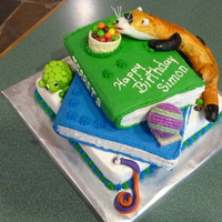 Ferret With Books Birthday Cake My ferret-loving grandson's birthday cake consisted of three layers of chocolate cake covered in white, blue and green buttercream....