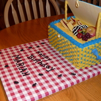 Picnic Basket Birthday Cake Made for my granddaughter's 14th birthday. Basket was three layers of yellow cake with strawberry filling covered in basket weave...