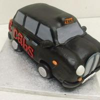 London Black Cab It's a London Black Cab, Loved making this. Its cake covered in cake crumbs and white chocolate and MMF on top of that. Wheels are...