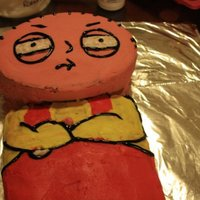 Stewie Griffin This was a birthday cake for the brother-in-law (before I smoothed out the buttercream) I used the Wilton oval cake pans for his head and a...