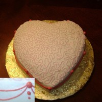 Valentine Cake This is a pink vanilla cake with all buttercream covering and decoration. White base with light pink continuous cornelli lace on top and...
