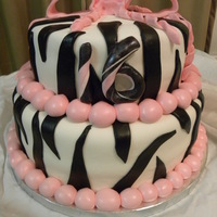 "Zebra Cake  For a sweet 16 Birthday. Bottom tier is a 10"" vanilla and top tier is an 8"" chocolate cake. Filled and covered with buttercream..."