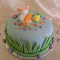 Easter Bunny Cake  Gluten-free vanilla cake filled with raspberry buttercream and covered in buttercream and MMF. Fondant figures. Inspired by many cakes on...