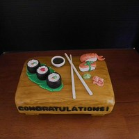 Sushi Cake Made this for my daughter to celebrate her new job! Everything on top of the cake is edible and made with gumpaste. TFL :-)