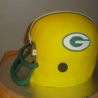 Packers Helmet A Packers helmet cake made for a friend who is a huge Packers fan. Devils Food and buttercream.