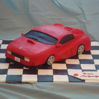 Ferrari Cake Ferrari Groom's cake. Peanut Butter Chocolate Chip cake w/ Cookies n' Creme filling. Lots of fun to make! Thanks for looking.