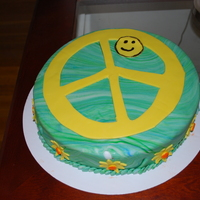 Savannah's Birthday Cake The birthday girl wanted blue, green and a peace sign. She was thrilled when she saw this!