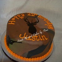 Happy Hunter's Birthday  This was a birthday cake that I was asked to do for someone who really loved hunting and fishing. I ended up hand painting the silhouettes...