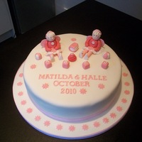 "Two Little Girls Christening Cake   i made this for a double christening.The cake is a 10"" cake iced with white sugarpaste.The fairies are made of modelling paste"