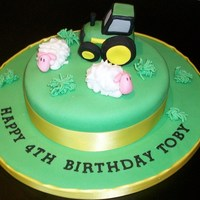 "Tractor Cake This cake was an 8"" vanilla sponge with jam and butter icing. The sheep and tractor was made of sugarpaste"