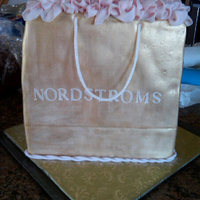 Nordstroms Bag A Nordstroms shopping bag for a bridal shower. The cake is covered in rolled fondant with gum paste tissue and handles.