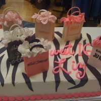Specialty Store Bags Cake   Sweet 16 birthday cake. Little sacks made out of gum paste.