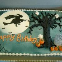 Halloween Birthday Cake  The tree, pumpkins and tombstone are made of modeling chocolate and the witch is airbrushed on from a stencil I made myself. Fun cake to do...