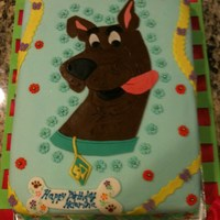 Scooby Doo Cake For Girl This cake was for a 5 year old girl's bday party. Who says that Scooby Doo is only for boys? :) It's a white cake with chocolate...