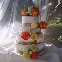 Rose Wedding Cake This cake was for an outdoor wedding taking place in a Japanese Garden. The biggest challenge was that I had to build the cake onsite and...