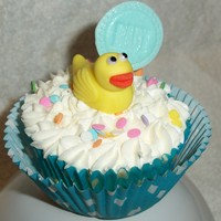 "Baby Shower Ducky Cuppie These are cupcakes I made for a baby shower with a ducky theme. I hand sculpted all of the ""rubber"" duckies out of MM fondant,..."