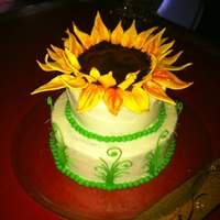 Sunflower Birthday Cake Chocolate espresso cake with caramel buttercream. The sunflower is made of chocolate modeling clay and gumpaste.