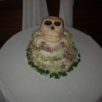 Skull & Crossbones Wedding Cake Couple wanted my traditional chocolate wedding cake with real buttercream frosting but with the top to be a skull. Skull is covered in...