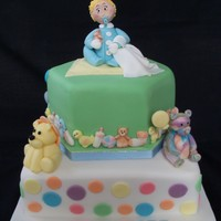 Baby Boy Christening Cake   2 tier cake, all hand made using sugar paste