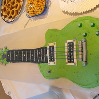 Guitar Groom's Cake Cake made for my niece's wedding groom cake. Chocolate cake with peanut butter cream frosting. The neck of the guitar is made of rice...