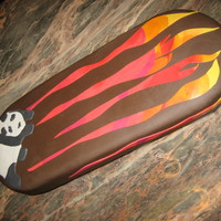 Flaming Skateboard Fondant on chocolate cake. Casters for wheels let this bad boy roll down the table to the delight of the skateboard crazy birthday boy....