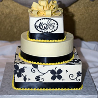 Black And Yellow Wedding Cake Buttercream iced cake with Fondant flowers applied to the bottom tier