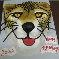 Cheetah In Buttercream First attempt at a sculpted cake.