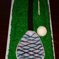 Lacrosse Stick   Double chocolate cake iced with buttercream. Full size lacrosse stick & ball molded from rice crispie treats. Very large cake!