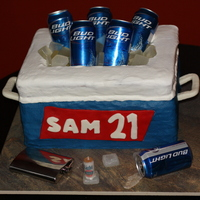 21St Birthday Four 12x18 stacked and carved WASC. Iced in buttercream. Name sign and handles made out of MMF. Isomalt ice cubes formed in silicone molds...