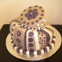 My First Topsy Turvey Cake This is a cake that I did in a Fondant/Gumpaste class. The main color is lavender even though it looks brown. It was fun to make but it was...