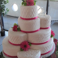 Staggered Wedding Cake  Eight tiered vanilla and almond wedding cake. The bride wanted a different pattern on each tier. The piped words are the lyrics from the...