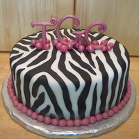 Zebra Stripes   Cake is covered with and stripes are made of marshmallow fondant. The initials are gumpaste.