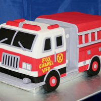 Firetruck Four layer sculpted birthday cake for a man training to become a volunteer firefighter.