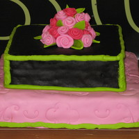 1St Fondant Cake My first fondant cake. I used Marshmallow Fondant.....yeah. The black however I had a hard time with because I added coco powder and I...