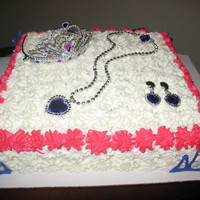 Princess Cake W/ Jewelry I have boys so I welcomed my neighbors request to do her daughters birthday cake. Princess and girly. The jewelry is a cheap set I picked...