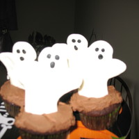 Ghost Cupcakes My sons birthday is in October and he wanted a halloween the cupcakes he took to school. I found a ghost shape I liked on line and printed...