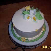 Spring's A Coming.   Marble cake with buttercream frosting & fondant decorations.