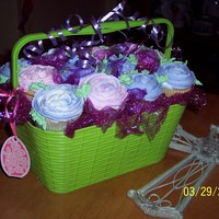 My First Cupcake Bouquet  I'm trying out different containers & this one seems to work. I used colored plastic wrap to fill the spaces in between. Please, I...