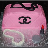 Chanel Purse This is a duplicate of my first purse cake I made. Thanks for looking :)