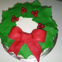 Wreath Cake made with buttercream and fondant leaves and bow and candies for the berries
