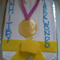 Taekwondo Cake Made for my sons class after a tournament. Buttercream with fondant accentsWould have like to spend more time on it, but it was a last...