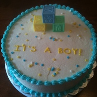 It's A Boy Vanilla cake filled with oreo and covered in buttercream