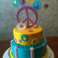 Peace & Posies two tiered cake with buttercream and decorated in fondant