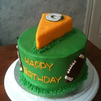 Cheesehead! White cake covered in buttercream with a fondant piece of cheese on top