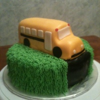1St Day Of School white cake with a reice krispie shaped bus covered in fondant