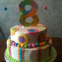 Turning 8 Is Great! vanilla cake with oero filling, covered in buttercream and decorated in fondant